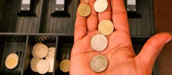mano-monedas-28122013-640x280